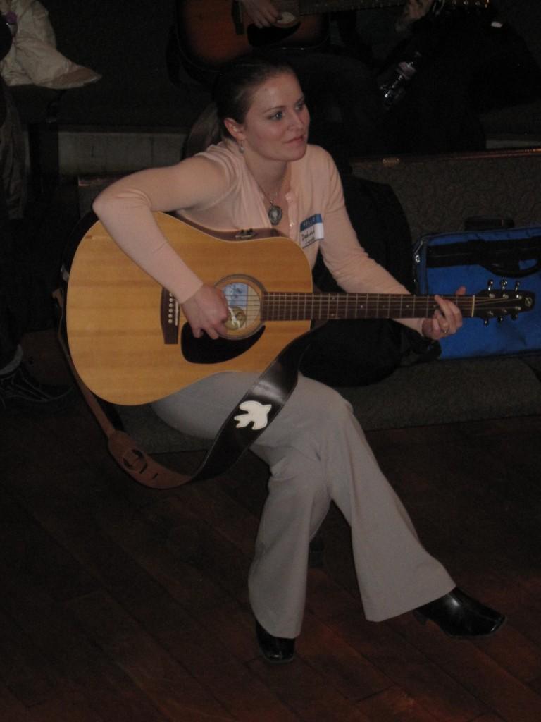 Music Therapist Playing Guitar