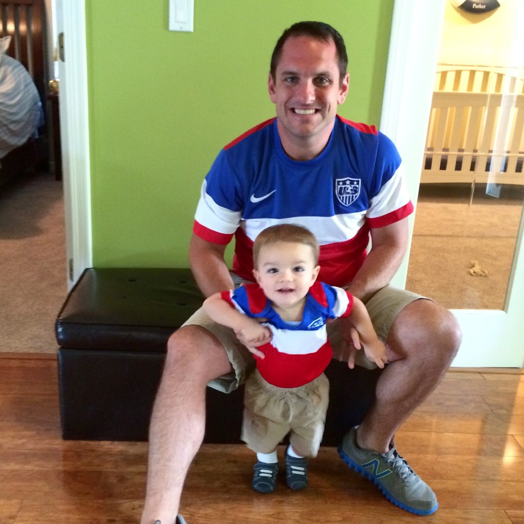 Parker and daddy in matching soccer gear for the World Cup finals